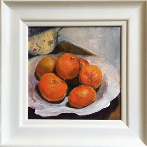 Clementines on vine plate