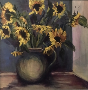 Large sunflowers in stoneware jug